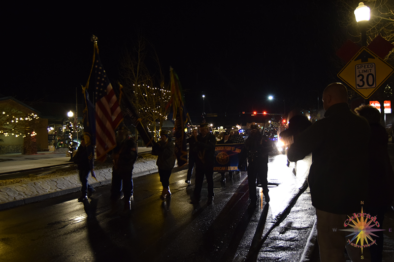 Christmas Parade Woodland Park Color Guard marching just behind the lead float in the Woodland Park Colorado