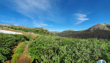 Cresting Williamson Pass the horizon opens up in a panoramic collage of color and beauty