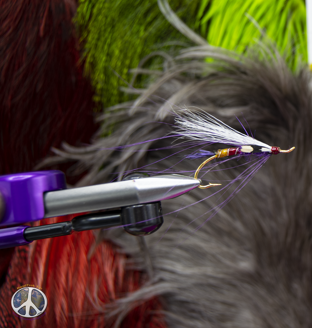 Late for the station spey fly tied wearing fly fishing apparel